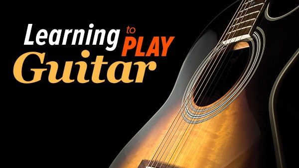 Learning to Play Guitar: Chords, Scales, and Solos